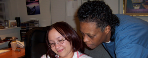 Founder Vaile Leonard assisting a woman
